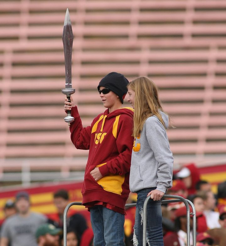 Jake Olson leads the marching band with his sister back in December 2009.