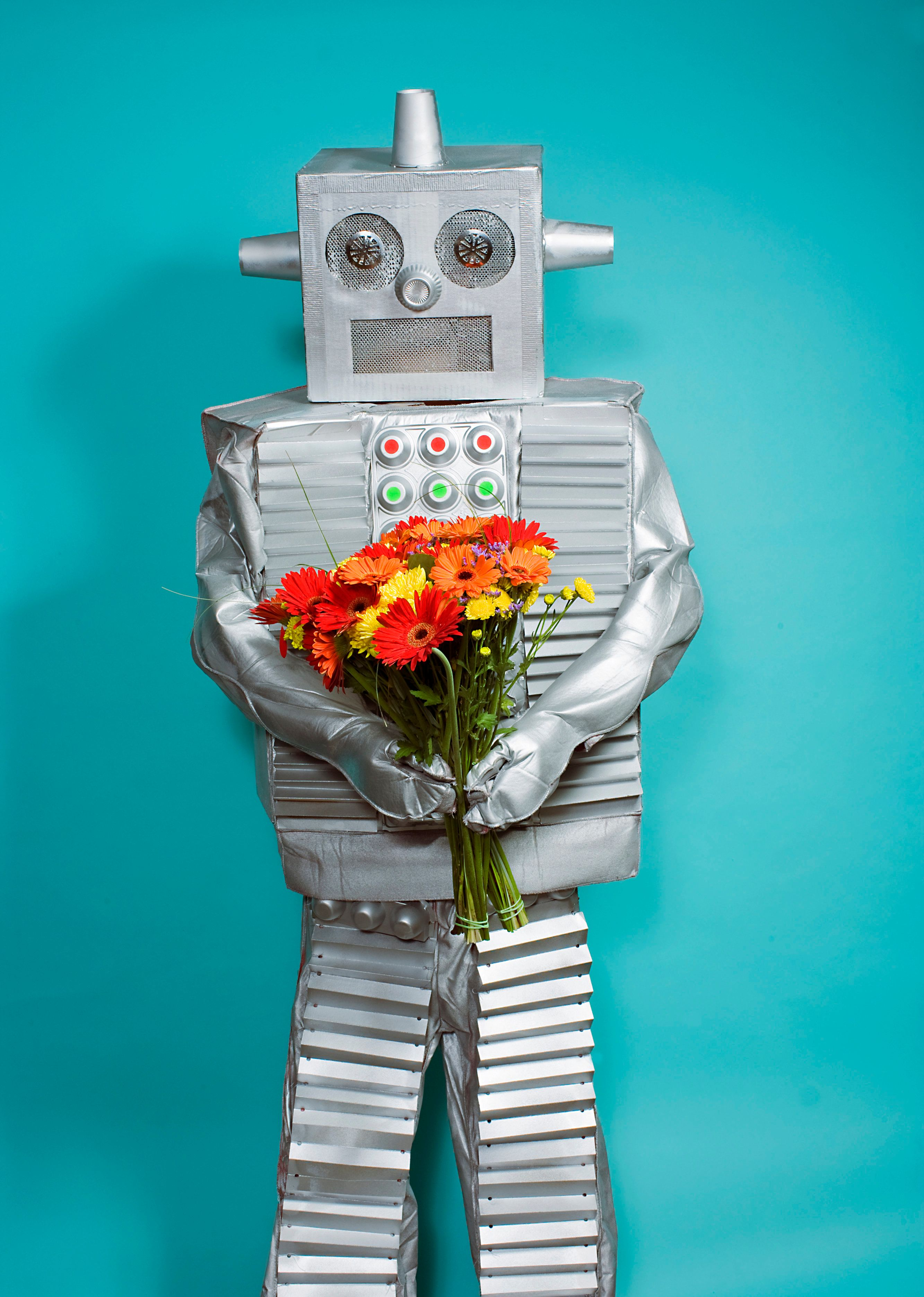 You know it's a real date when the robot brings flowers.