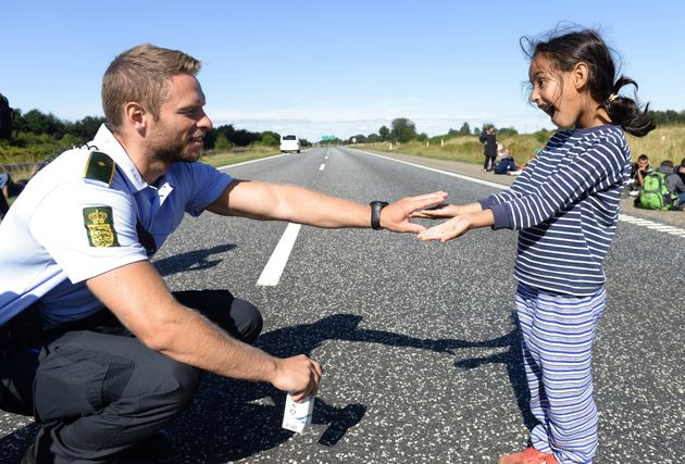 Danish Police Officer Shares Playful Moment With Syrian Refugee
