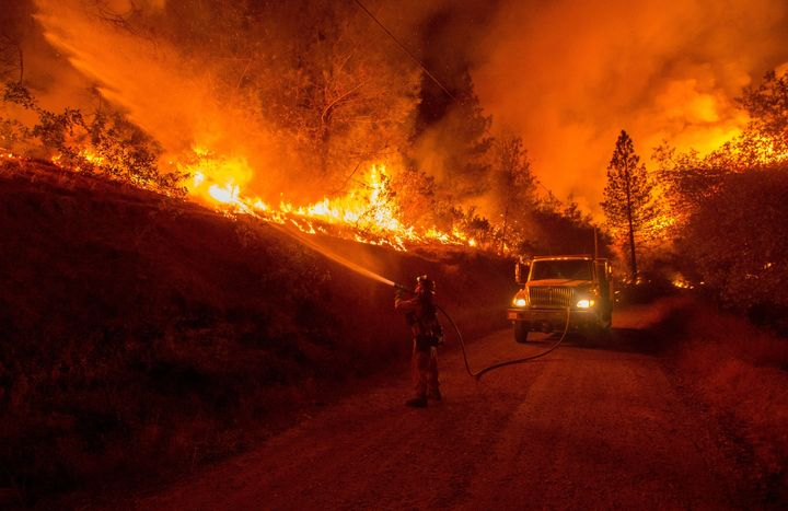 A firefighter douses flames from a backfire while battling the Butte fire near San Andreas, California, on Sept. 12. Wildfire