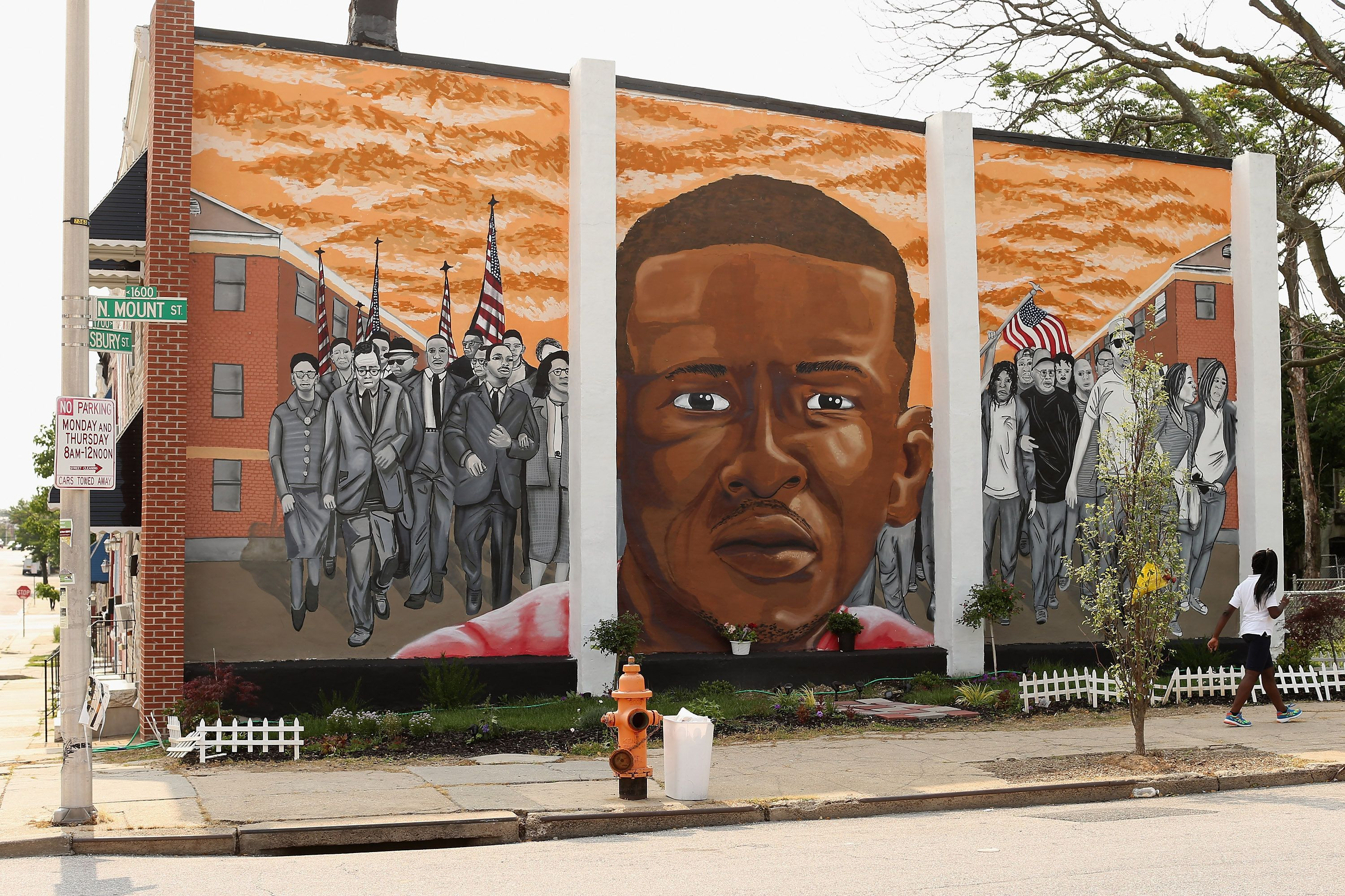 A mural of Freddie Gray went up near where he was tackled and arrested in April.