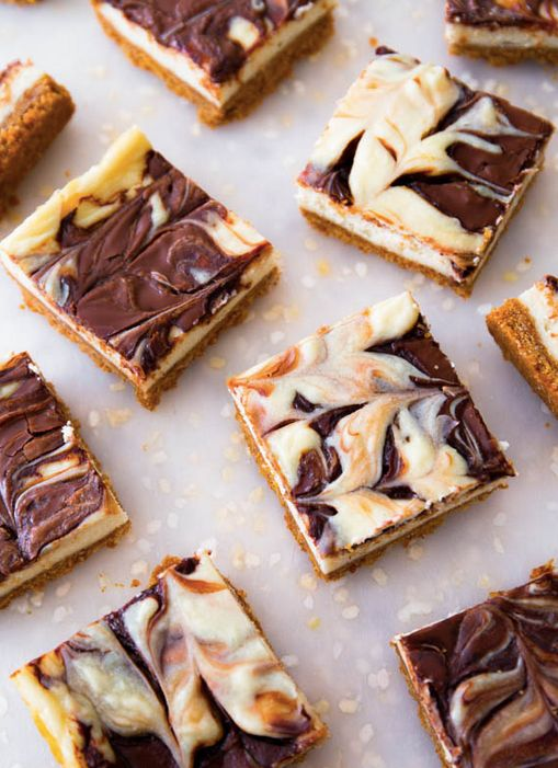 "<strong>Get the <a href=""http://sallysbakingaddiction.com/2013/11/30/nutella-swirl-cheesecake-bars/"" target=""_blank"">Nutella"
