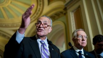 UNITED STATES - SEPTEMBER 9: Sen. Chuck Schumer (D-NY) and Senate Minority Leader Harry Reid (D-NV) speak during the post policy lunch media availability in the Ohio Clock Corridor in the Capitol on Wednesday, Sept. 9, 2015. (Photo By Bill Clark/CQ Roll Call)