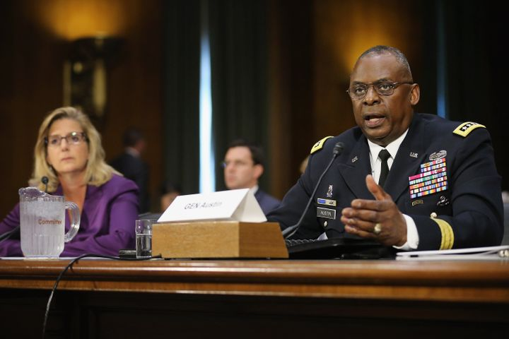 Gen. Lloyd Austin III, right, testifies before the Senate Armed Services Committee about the ongoing U.S. military operations