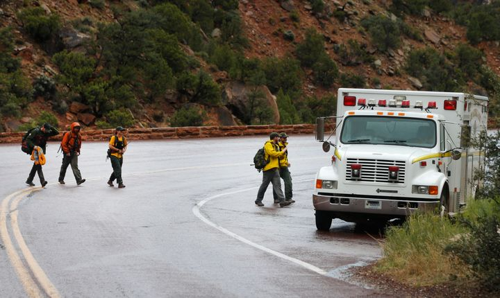 Search and rescue personal finish their day of searching Pine Creek in Zion's National Park for lost hikers on September 15,