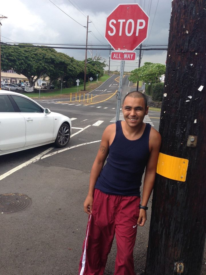 Justin Guy stands at the intersection in Kailua-Kona where he was cited for panhandling in June 2014.