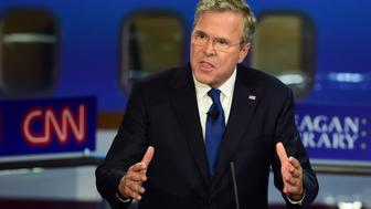 Republican presidential hopeful, former Florida Gov. Jeb Bush,  gestures while speaking during the Presidential debate at the Ronald Reagan Presidential Library in Simi Valley, California on September 16, 2015.  Republican presidential frontrunner Donald Trump stepped into a campaign hornet's nest as his rivals collectively turned their sights on the billionaire in the party's second debate of the 2016 presidential race.  AFP PHOTO / FREDERIC J. BROWN        (Photo credit should read FREDERIC J BROWN/AFP/Getty Images)