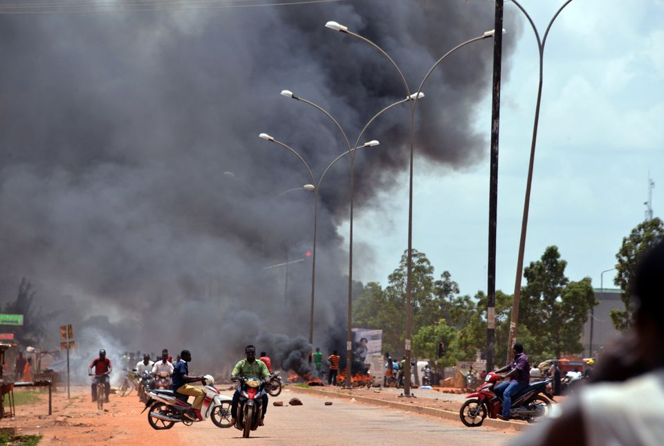 Residents burn tires along a street in Ouagadougou on September 17, 2015. (AHMED OUOBA/AFP/Getty Images)