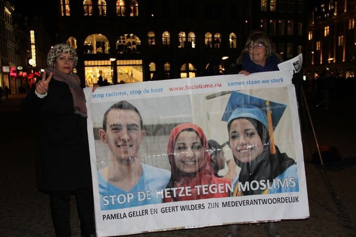 People attenda vigil in Amsterdam on Feb. 13, 2015, for three Muslim students who were shot dead in Chapel Hill, North