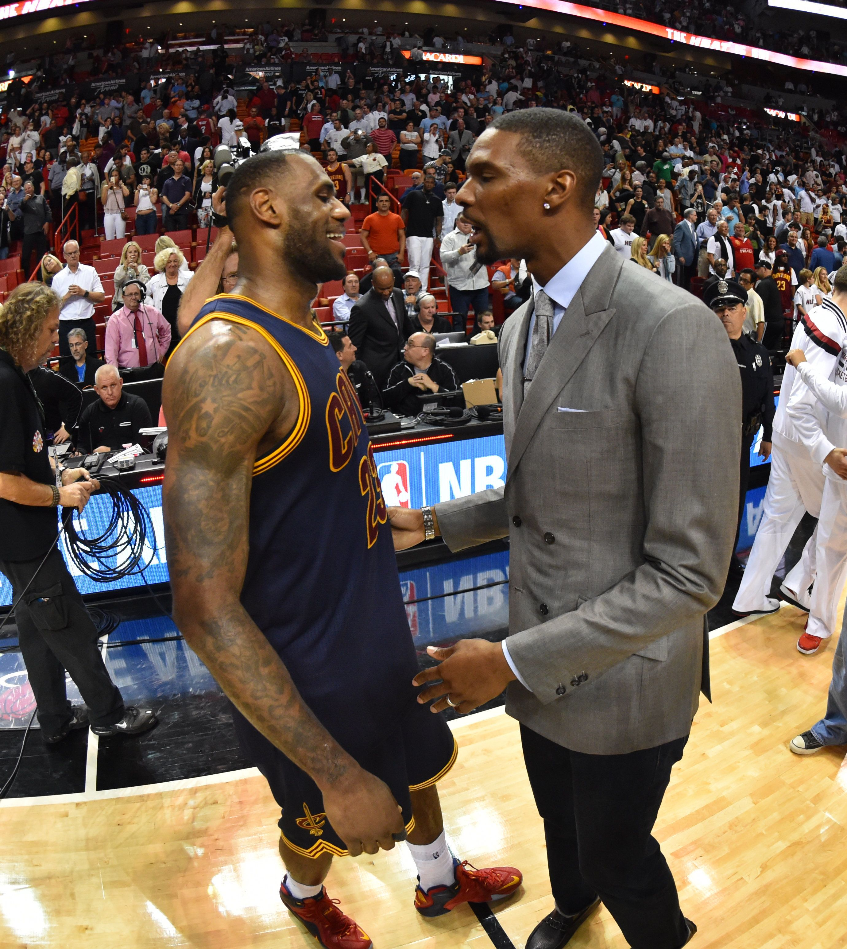 MIAMI  - MARCH 16:  LeBron James #23 of Cleveland Cavaliers greets former teammate Chris Bosh #1 after the game against the Miami Heat at the American Airlines Arena on March 16, 2015 in Miami , Florida. NOTE TO USER: User expressly acknowledges and agrees that, by downloading and or using this photograph, User is consenting to the terms and conditions of the Getty Images License Agreement. Mandatory Copyright Notice: Copyright 2015 NBAE  (Photo by Jesse D. Garrabrant / NBAE via Getty Images)