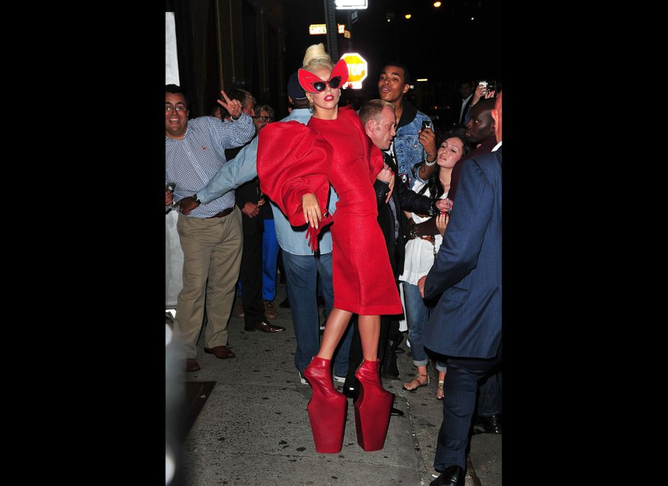 The crimson towers on her feet aren't even the most distracting part of this look.