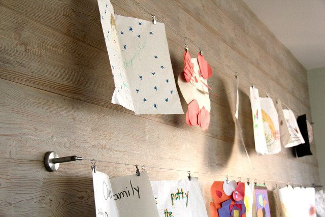 Curtain wire and clips are perfect for displaying kids' art because you can interchange the artwork!  Get the instructions he