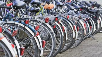 row parked bicycles in amsterdam