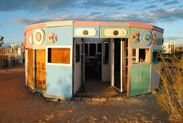 """Noah Purifoy's Outdoor Museum in Joshua Tree. It's the most beautiful outdoor museum of junk arranged into a sort of city --"