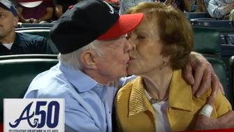 Jimmy Carter shares a kiss with his wife, Rosalynn.