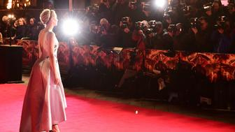 Jennifer Lawrence arriving at the UK film premiere of The Hunger Games: Mockingjay, Part 1, at the Odeon in Leicester Square, London. PRESS ASSOCIATION Photo. Picture date: Monday November 10, 2014. See PA story SHOWBIZ Hunger. Photo credit should read: Ian West/PA Wire