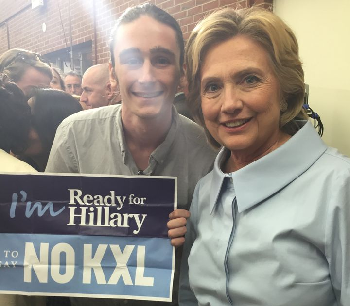 Hillary Clinton poses with anti-Keystone XL activist Griffin Sinclair-Wingate. Clinton said she'd soon tell the public w