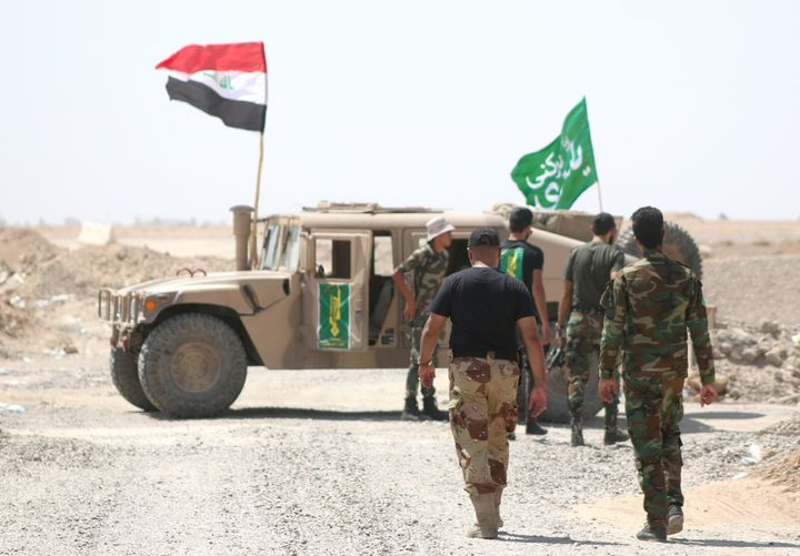 Shiite militia fighters on the front line against the Islamic State group in Iraq's Anbar province on Aug. 19.