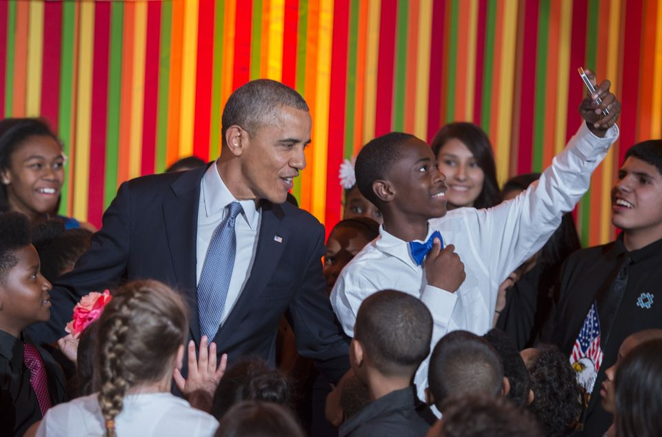 A student takes a selfie with U.S. President Barack Obama at the White House Talent Show in Washington, D.C., on May 20,