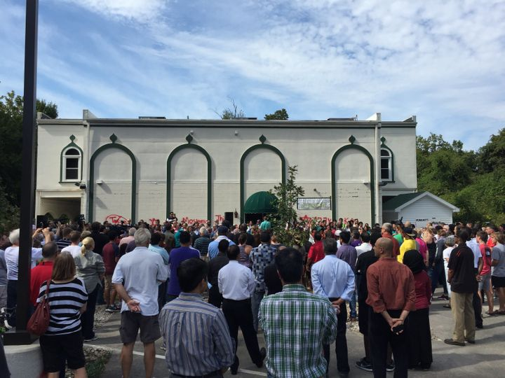 Louisville residents gather for a clean up at the vandalized Islamic Center.