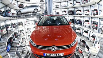 A VW Passat (L) and a VW Golf are pictured inside the so-called cat towers of car manufacturer Volkswagen AG (VW) at the company's assembly plant in Wolfsburg March 10, 2015. AFP PHOTO / TOBIAS SCHWARZ        (Photo credit should read TOBIAS SCHWARZ/AFP/Getty Images)