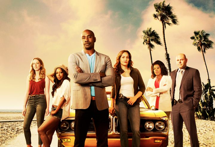 """Morris Chestnut (center) and Jaina Lee Ortiz pose with the cast of """"Rosewood."""""""