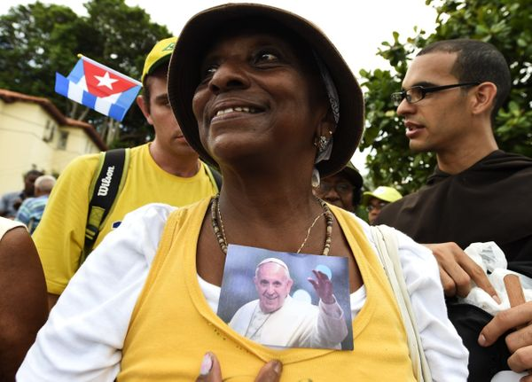 A woman holds a photo of Pope Francis during his visit in Havana on September 19, 2015, on the first leg of a high-profile tr