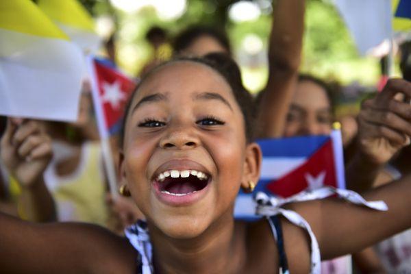HAVANA, CUBA - SEPTEMBER 19: Cuban kid celebrates Pope Francis arrival in Havana, Cuba on September 19, 2015. (Photo by Carlo