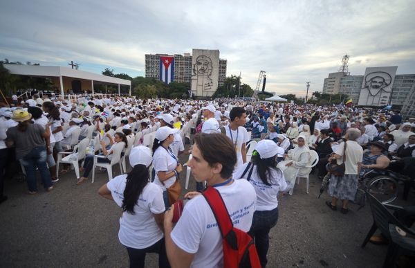 People wait for the start of the mass to be officiated by Pope Francis at Revolution Square in Havana, on September 20, 2015.