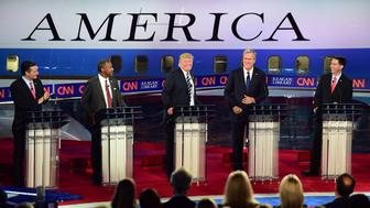 Republican presidential hopefuls Ted Cruz, Ben Carson, Donald Trump, Jeb Bush, and Scott Walker participate in the Republican Presidential Debate at the Ronald Reagan Presidential Library in Simi Valley, California on September 16, 2015.  Republican presidential frontrunner Donald Trump stepped into a campaign hornet's nest as his rivals collectively turned their sights on the billionaire in the party's second debate of the 2016 presidential race.  AFP PHOTO / FREDERIC J. BROWN        (Photo credit should read FREDERIC J BROWN/AFP/Getty Images)