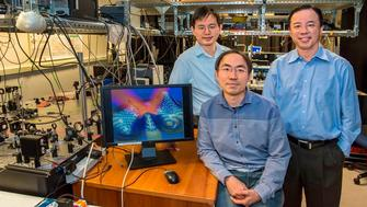 """(From left) Yuan Wang, Zi Jing Wong and Xiang Zhang have devised an ultra-thin invisibility """"skin"""" cloak that can conform to the shape of an object and conceal it from detection with visible light."""