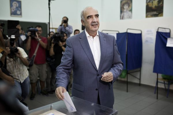 Vangelis Meimarakis casts his ballot at a polling station in Athens on Sunday, Sept. 20, 2015.