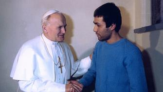 Pope John Paul II shakes hands with his would-be assassin, Mehmet Ali Agca onDecember 27, 1983. Ali Agca shot and wounded the pope onMay 13, 1981 in St. Peter's Square in Rome.