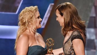 LOS ANGELES, CA - SEPTEMBER 20:  Actress Allison Janney (R) accepts Outstanding Supporting Actress in a Comedy Series award for 'Mom' from actress Amy Schumer onstage during the 67th Annual Primetime Emmy Awards at Microsoft Theater on September 20, 2015 in Los Angeles, California.  (Photo by Kevin Winter/Getty Images)
