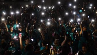 WASHINGTON, DC - APRIL 7: Gallaudet University students, faculty, and staff use their phones as a light source as the power temporarily went out during a rally and protest against sexual violence on April 7, 2015 in Washington, D.C. The university is promoting the 'It's On Us' campaign, a White House-led initiative which asks men and women across America to make a personal commitment to be a part of the solution to combat campus sexual assaults. (Photo by Ricky Carioti/The Washington Post via Getty Images)