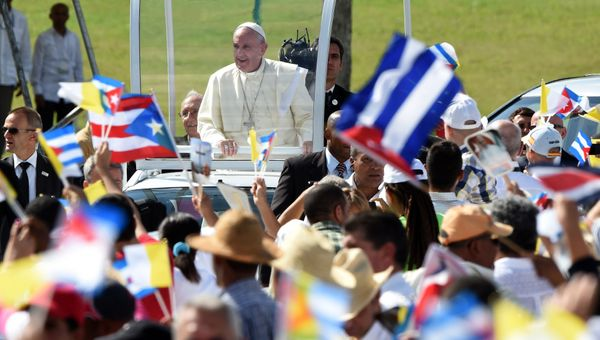 Pope Francis is greeted by the crowd as he arrives to give a morning mass at the Calixto Garcia square in Holguin, in eastern
