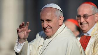 Pope Francis greets people as he arrives at the Sant' Ignazio di Loyola church on April 24, 2014 in Rome.