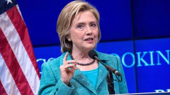 US Democratic presidential candidate Hillary Clinton speaks about the Iran nuclear deal at the Brookings Institution in Washington, DC, on September 9, 2015. Clinton expressed firm support for the nuclear accord with Iran, calling it flawed but still strong. Clinton added that the agreement must be strictly enforced and said that if elected president next year, she would not hesitate to use military force if Iran fails to live up to its word and tries to develop a bomb.   AFP PHOTO/NICHOLAS KAMM        (Photo credit should read NICHOLAS KAMM/AFP/Getty Images)