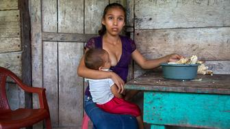 """Aracely, 15, of Guatemala holds her infant. """"What I hope is to keep moving forward ... to see how I can get my boy ahead. The hard thing, maybe ... when he gets older and he leaves ... that's when is going to be hard for me. When he is older. Because he is the one who will help me get ahead."""" Aracely is one of the half a million of Guatemalan girls who marry and give birth before they can legally vote, drink or buy cigarettes.&nbsp;<br /><br />"""