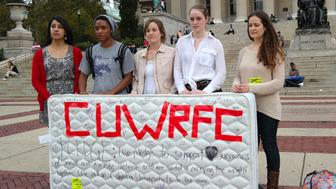 Students stand in front of the Library of the Columbia University with a mattress in protest of the university's handling of sexual assault.