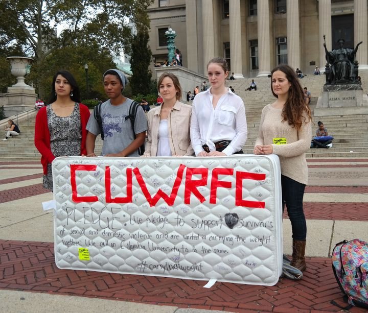 Students stand in front of the Library of the Columbia University with a mattress in protest of the university's handling of