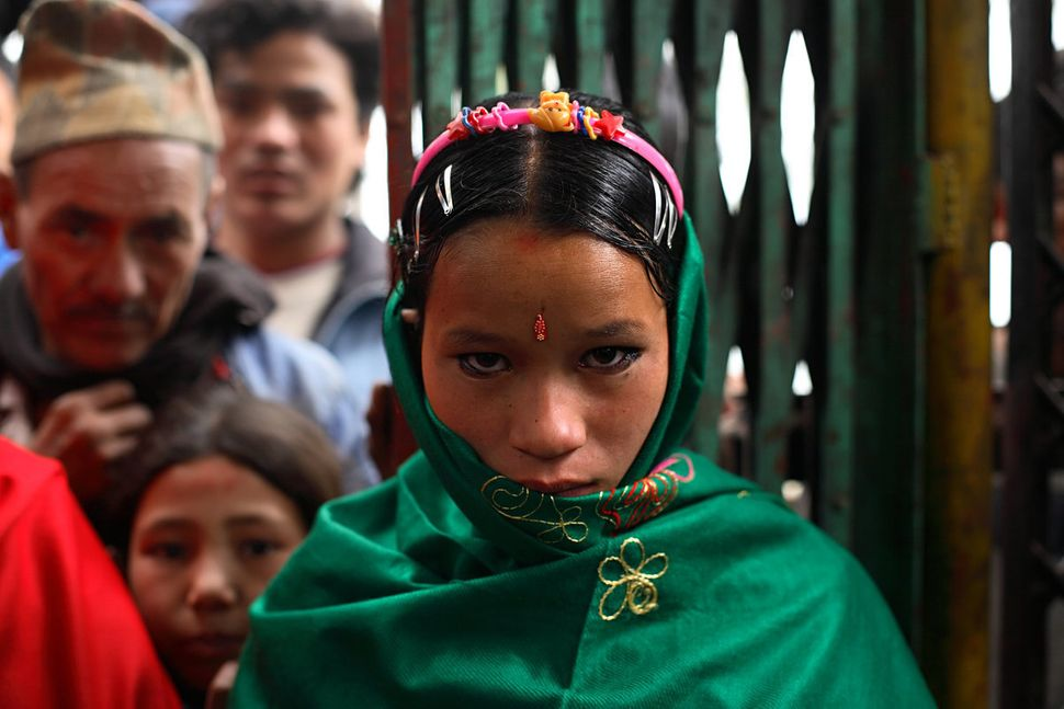 Niruta, 14, arrives at the wedding ceremony in Kagati Village, Kathmandu Valley, Nepal on Jan. 23 ,2007. Niruta moved in with