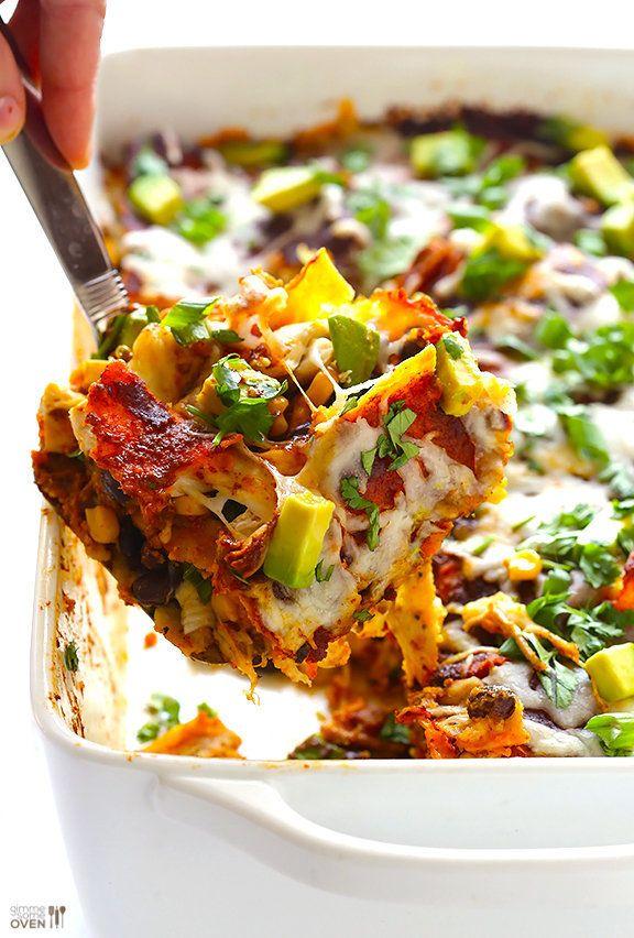 "<strong>Get the <a href=""http://www.gimmesomeoven.com/chicken-enchilada-casserole-recipe/"" target=""_blank"">Chicken Enchilada"