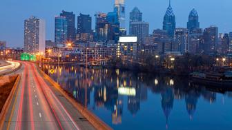 Image of Philadelphia skyline, Schuylkill River and busy highway leading in to the city during sunset.