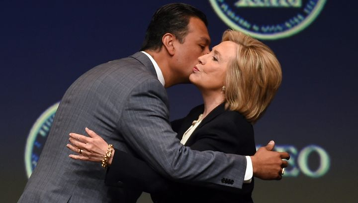 California Secretary of State Alex Padilla (L) greets Democratic presidential candidate and former U.S. Secretary of State Hi