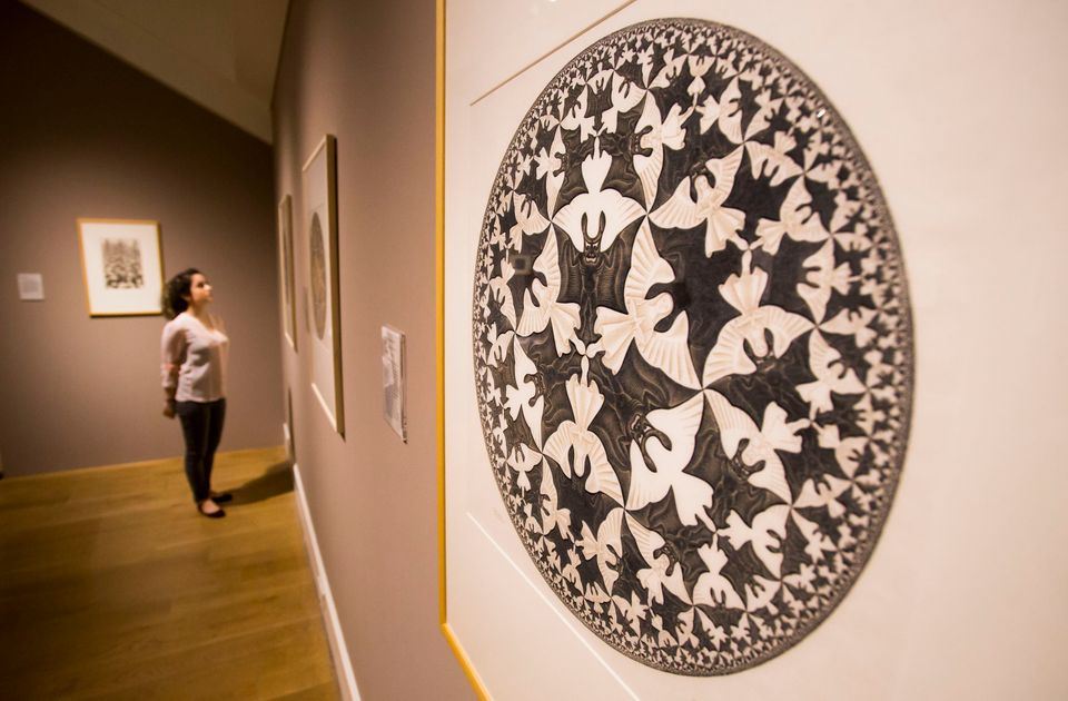 National Galleries of Scotland employee Adeline Amar with a work by M.C. Escher ahead of a major retrospective of the artists