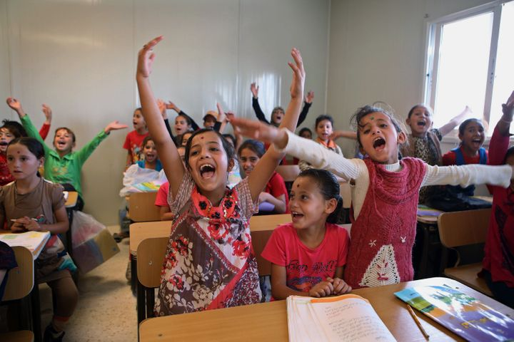 Syrian refugee students welcome as German Economy Minister Sigmar Gabriel visits the classroom during his visit at the Zaatar