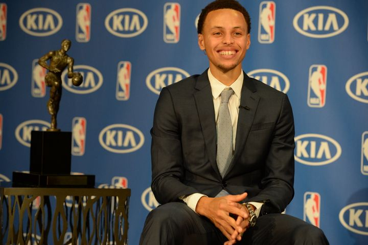 Curry with his 2014-2015 MVP trophy.