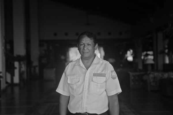 Emil, a security guard at one of Saipan's high-end hotels, lost his home in the typhoon. Lin took this photo days after
