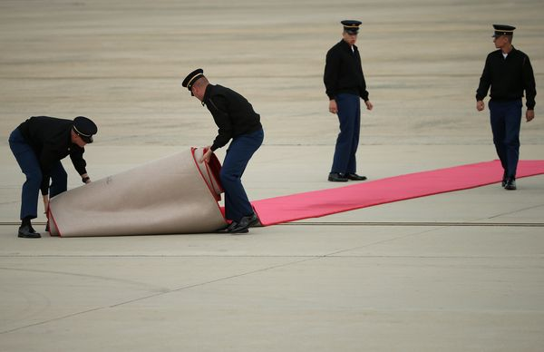 JOINT BASE ANDREWS, MD - SEPTEMBER 22:  Members of the Army's 3rd U.S. Infantry Regiment, or The Old Guard, roll out the red